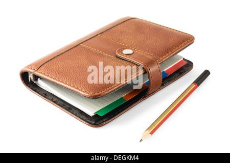 Notizbuch und Stift isoliert auf weiss - Stockfoto
