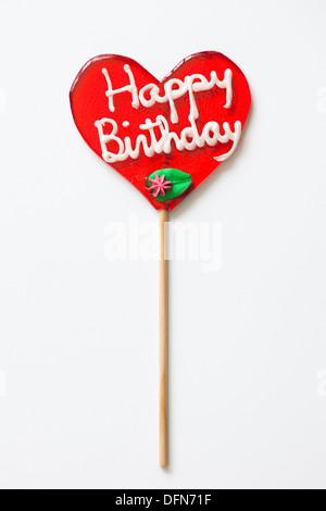 Lutscher mit Happy Birthday in Herzform - Stockfoto