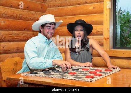 junge westliches paar Dame spielen - Stockfoto