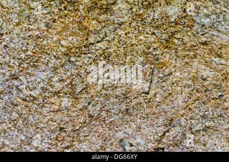 Die Struktur des natürlichen fleckig braun-gelb-grauen Granit-Stein - Stockfoto