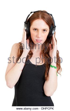 Junge Frau Hören von Musik - Stockfoto