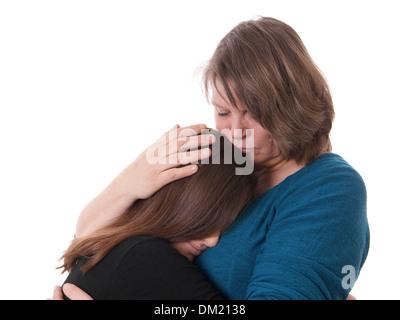 Mutter tröstet ihre Tochter - Stockfoto