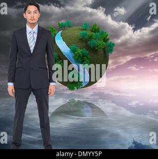 Zusammengesetztes Bild des schweren asiatischen Geschäftsmann - Stockfoto