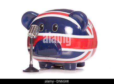 Sparschwein mit Retro-Mikrofon-Ausschnitt - Stockfoto