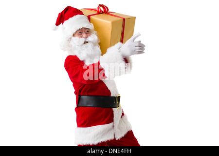 Santa Claus mit schweren Weihnachtsgeschenk - Stockfoto