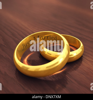 Gravierte goldene Eheringe auf hölzernen defokussierten Hintergrund, heiratete Just - Stockfoto