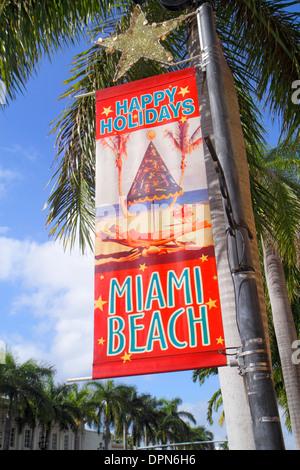 Miami Beach Florida 41st Street Arthur Godfrey Boulevard Banner Frohe Feiertage Stadt - Stockfoto