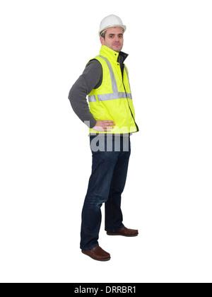 Porträt des Ingenieurs mit Schutzhelm und gelbe reflektierende Warnweste - Stockfoto