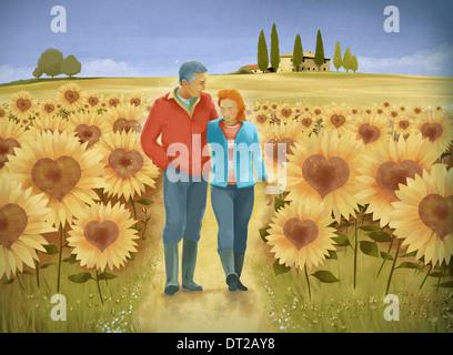 Anschaulichen Bild der älteres paar Wandern im Sonnenblumenfeld Vertretung glücklich im Ruhestand Leben - Stockfoto