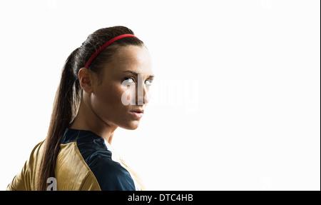 Studio-Porträt der jungen weiblichen Fußballspieler und-Trainer - Stockfoto