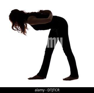 Frau dabei intensive Seite Stretch posieren in Yoga, Silhouette (Serie mit dem gleichen Modell verfügbar) - Stockfoto