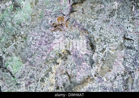 Textur aus Naturgranit grau, rosa und grüner Stein - Stockfoto