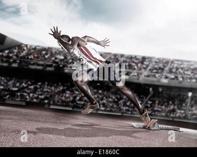 Läufer vom Startblock auf dem richtigen Weg - Stockfoto