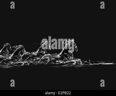 Eine Gruppe von Pferden aus Wasser galoppieren im Wasser auf einem schwarzen Hintergrund gemacht. - Stockfoto