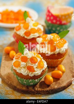 Cupcakes mit Kumquats. Rezept zur Verfügung. - Stockfoto