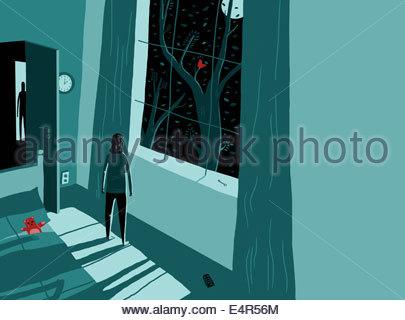 Frau aus Fenster mitten in der Nacht Angst - Stockfoto