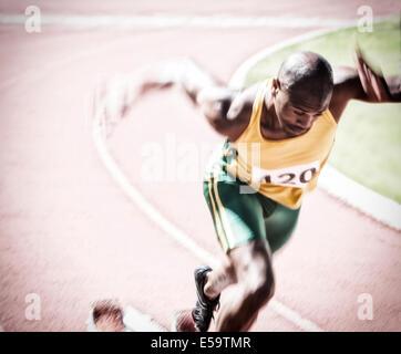Sprinter vom Startblock - Stockfoto
