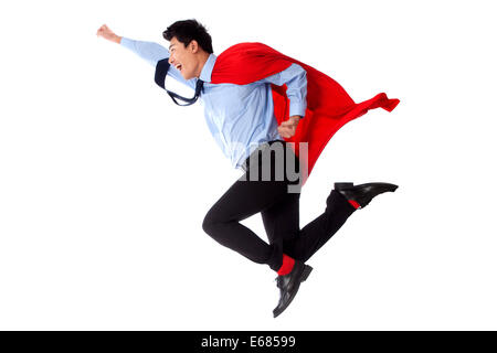 Junger Mann und junge Frau in Superman outfit - Stockfoto