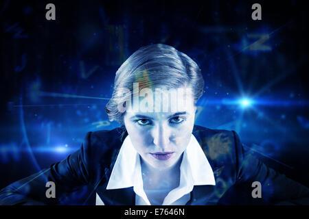 Zusammengesetztes Bild des fokussierten Geschäftsfrau - Stockfoto