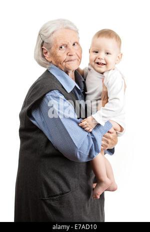 Porträt von einem senior Großmutter Holding Enkel über weiß - Stockfoto