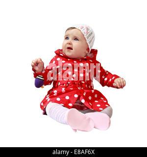 Kleinkind sitzt und Halt Spielzeug in der Hand isoliert auf weißem Hintergrund - Stockfoto