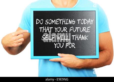 Mann Tafel in den Händen halten und zeigen das Wort tun heute, dass IHRE Zukunft selbst wird danke für etwas - Stockfoto