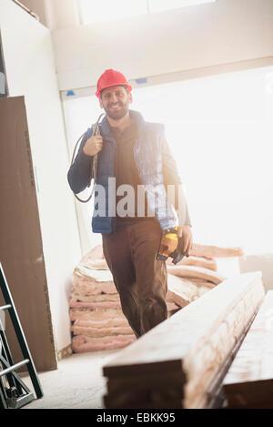 Lächelnde Bauarbeiter - Stockfoto