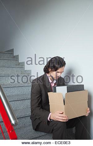 Man depressiv traurige Arbeitslosen allein besorgt - Stockfoto