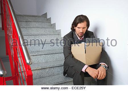 Sad deprimiert Arbeitslosen Arbeitslosen Mann allein - Stockfoto