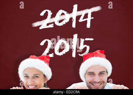 Zusammengesetztes Bild festliche jungen Paares lächelnd in die Kamera Stockfoto