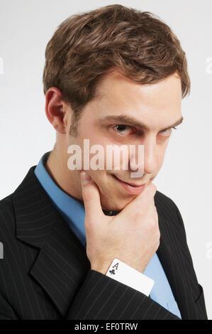 Geschäftsmann mit einer Karte im Ärmel - Stockfoto