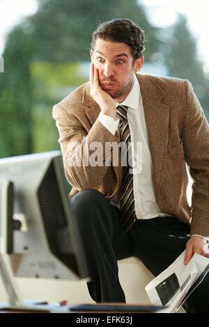 Mann bei der Arbeit gestresst - Stockfoto