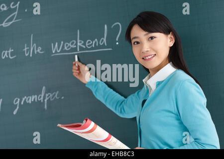 Der Lehrer im Klassenzimmer - Stockfoto