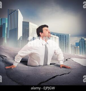 Geschäftsmann versinkt in Verzweiflung - Stockfoto