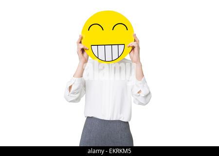 Junge Unternehmerin ein glückliches Smiley Gesicht vor ihr Gesicht halten - Stockfoto