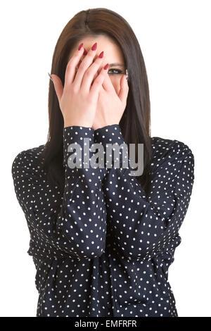 Schüchternes Mädchen vertuschen ihr Gesicht mit den Händen, isoliert - Stockfoto