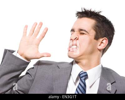 Geschäftsmann gegen Glas gefangen - Stockfoto