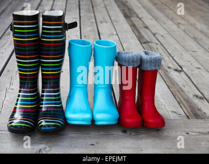 Drei paar bunte Regenstiefel - Stockfoto