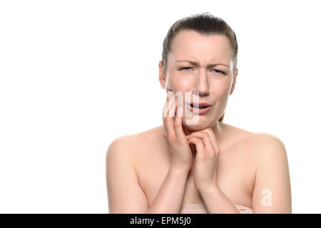 Junge Frau trägt Tube Tops, leiden aus ein sehr schmerzhaft Zahnschmerzen, hält ihr Gesicht während weinend in die - Stockfoto