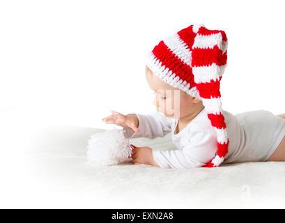 Baby in rot weiße Strickmütze - Stockfoto