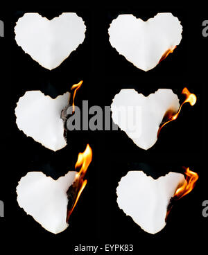 Herz Form Papier Brennen auf schwarzem Hintergrund - Stockfoto
