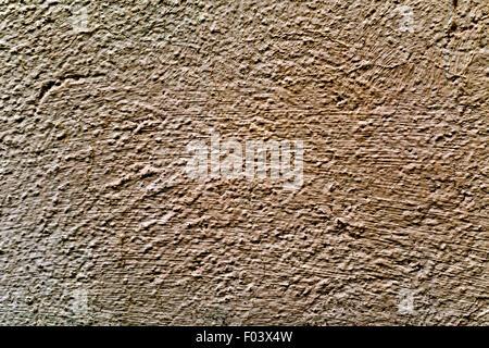 Nahaufnahme einer rustikalen Braun verputzten Wand - Stockfoto