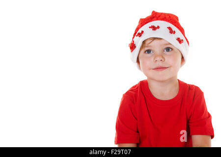 Jungen tragen eine Weihnachtsmütze auf der Suche von der Kamera entfernt. - Stockfoto