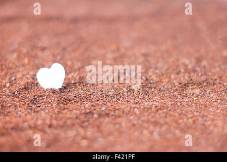 Herz auf Kakaopulver - Stockfoto