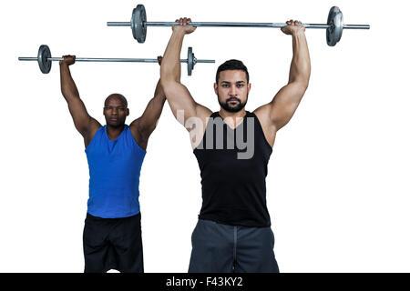 Man Hebe Langhantel mit trainer - Stockfoto