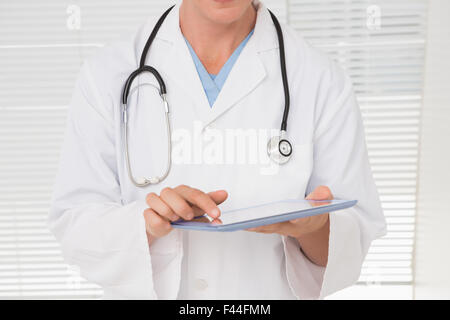 Arzt mit TabletPC - Stockfoto