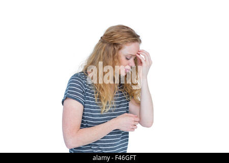 Frau mit Kopfschmerzen, die Nase kneifen - Stockfoto