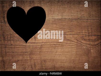 Herzform geschnitten auf Holzwand, Toilette, wc-Tür oder Fenster - Stockfoto