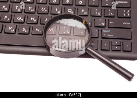 Lupe am schwarzen Tastatur - Stockfoto