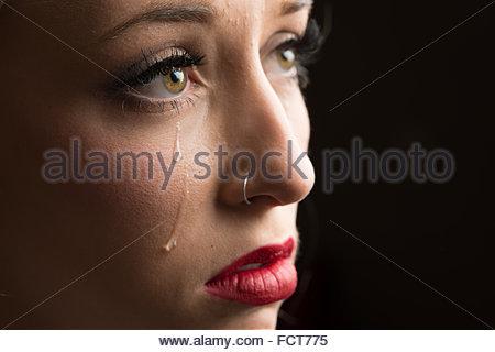 Nahaufnahme Foto einer jungen Frau, die weint. - Stockfoto